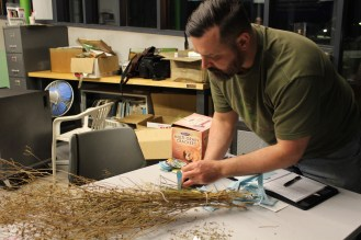 New seed library member Chad checking out some of the seeds in the Raíces EcoCulture Seed Library.