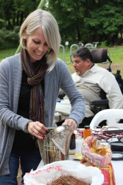 Javier's wife Amy lighting the smoker, one of the most important tools in beekeeping.