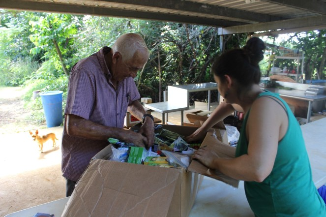 Don Luis picking out the seeds varieties he wanted to grow from our donations.