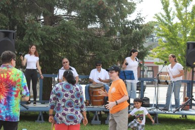Raíces Cultural Center Student Ensemble playing bomba, an Afro-puertorican tradition of drum, dance and song. Members of the audience dance along.
