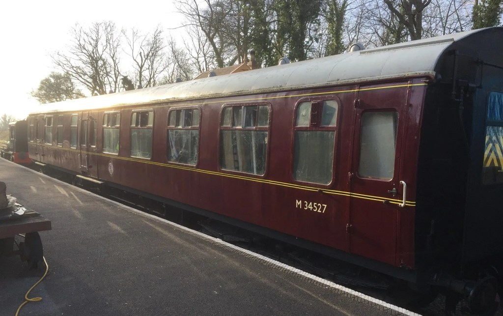British Railways Mark 1 railway carriage M34527 in the platform at Midsomer Norton station