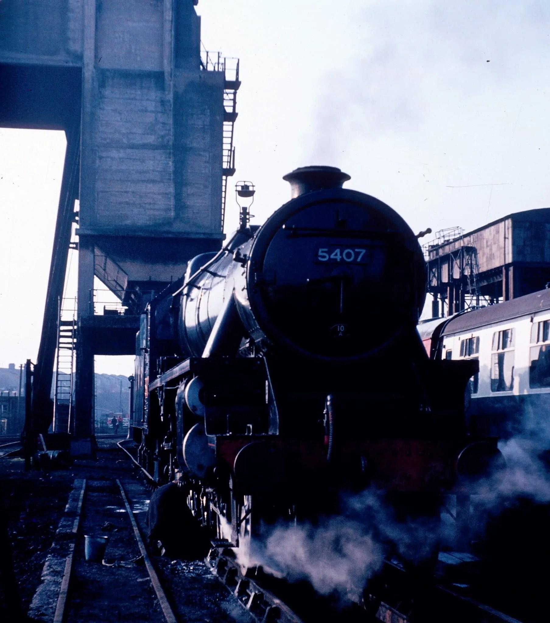 Steam locomotive Stanier Black Five 5407 Carnforth under coaling towers