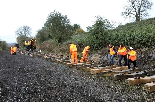 Some of the Mott MacDonald graduate engineers barring sleepers into alignment at the somerset and dorset railway extension