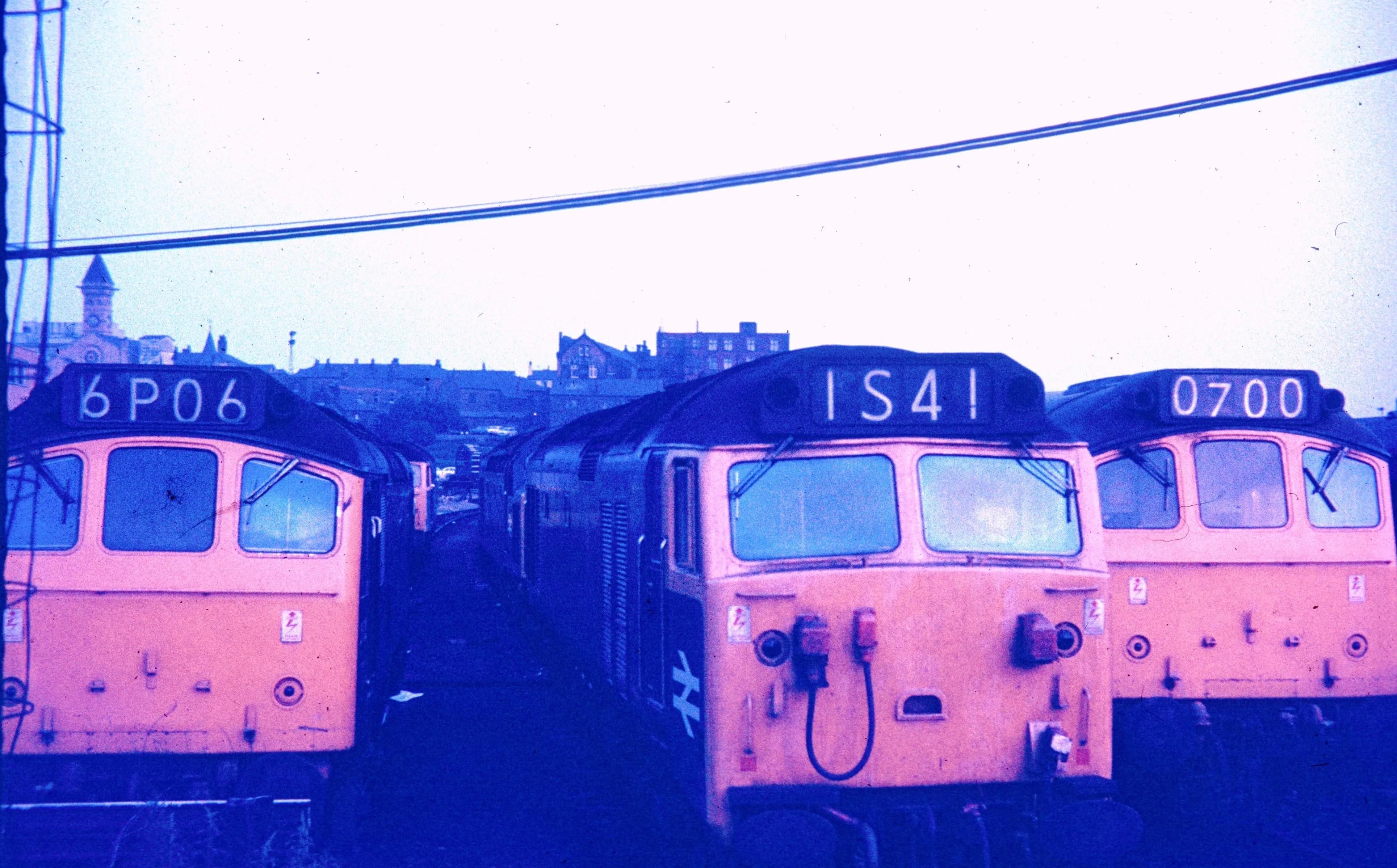 Class 50 diesel locomotive sandwiched between two Class 25 diesel locomotives at Preston