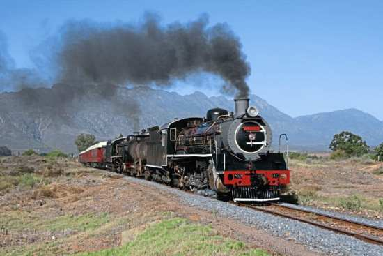 The new owner of the line through Michell's Pass – Transnet Freight Rail – has given its locos names: Ceres Railway coal-fired Class 19B No. 1412 (Berliner Maschinenbau 9838/1930) Bailey plus oil-burning Class 19D No 3321 Jessica (North British 1948/26041) are seen working en route from Voorbaai to Ceres via Worcester on March 14. No. 1412 had just been overhauled in Voorbaai for Ceres Rail by Transnet, and this special train was used to move it to its new home. JEAN DULEZ