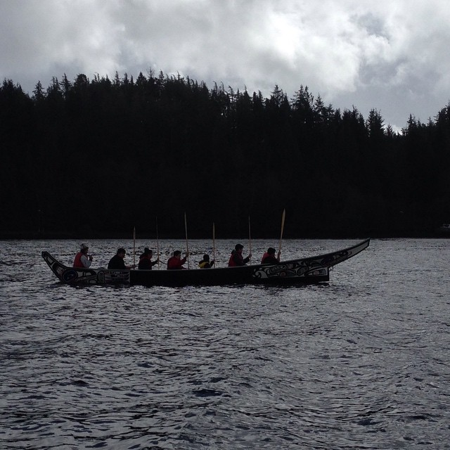 silhouette of a boat with heiltsuk youth paddling to help close down commercial sac roe fishing