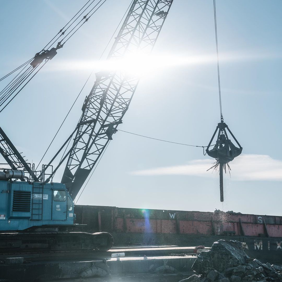Crane works at dredging Fraser River Estuary