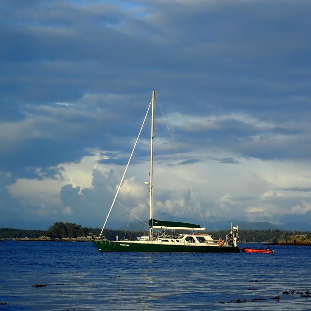 Raincoast boat Achiever is seen on blue waters under blue sky