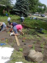 Planting rain garden by the community