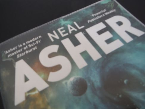 Part of the book cover for Infinity Engine by Neal Asher
