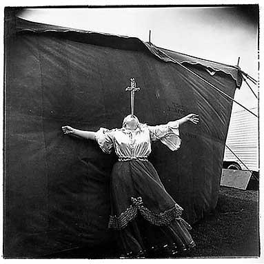Albino Sword Swallower at a Carnival