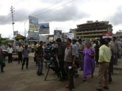 People looking at RTI Countdown signboard at Khyndai Lad parking lot