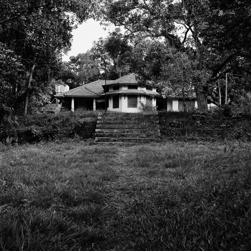 """The old house on the hill wore its steep, gabled roof pulled over its ears like a low hat..."" The God of Small Things - Photo by Dayanita Singh"