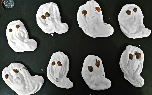 little ghost shaped meringues with chocolate eyes