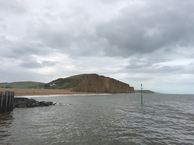 the sea, beach and cliff side at West Bay in dorset