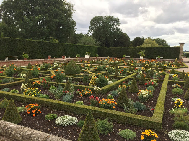 a sunken garden full of greenery and flowers