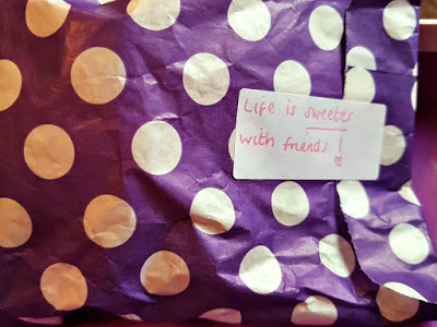 a bag of sweets with a sticker saying, life is sweeter with friends