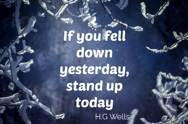 a frosty twig with the quote, if you fell down yesterday, stand up today by H.G. Wells