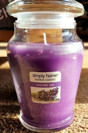 a lavender candle in a glass jar