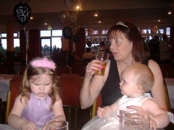 a photo of me and my two little girls at a party.