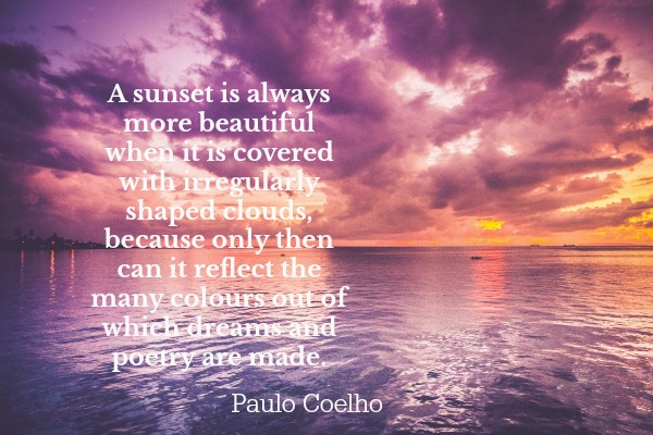 a beautiful sunset shining through the clouds