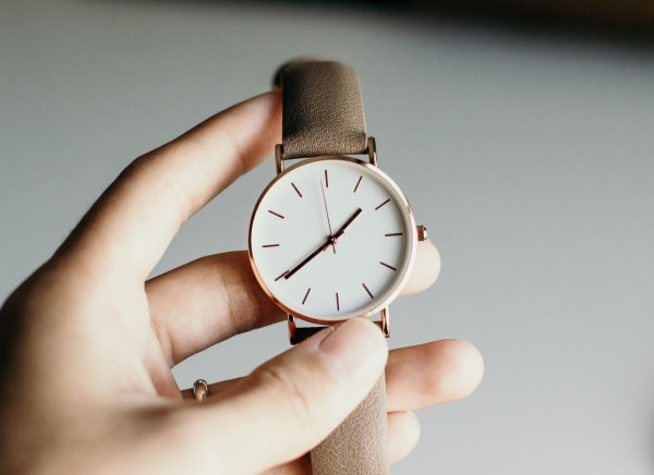 Hand holding a watch