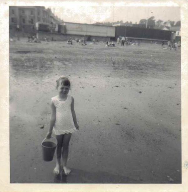 a little girl on the beach, black and white photograph taken in 1971