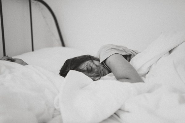 a woman in bed, black and white photo