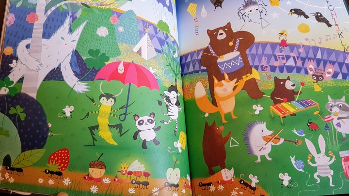 pages from the book showing woodland creatures playing musical instruments