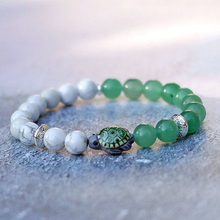 a green stone bracelet with a turtle charm. from etsy