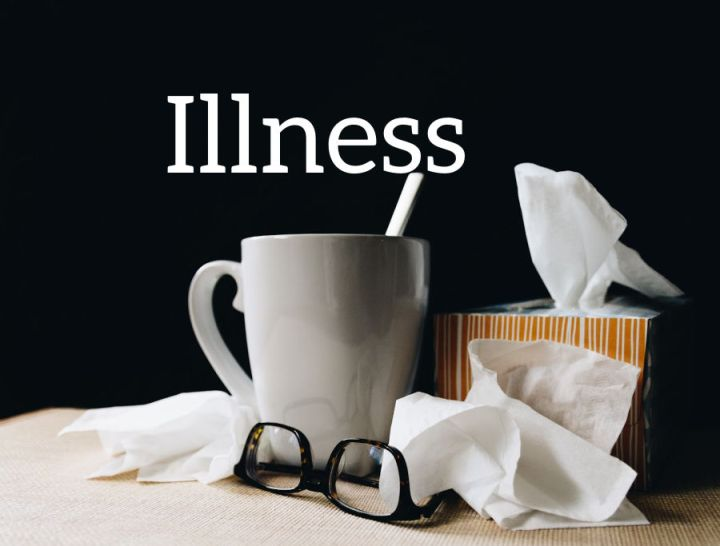 Illness, a cup and box of tissues against a dark background.