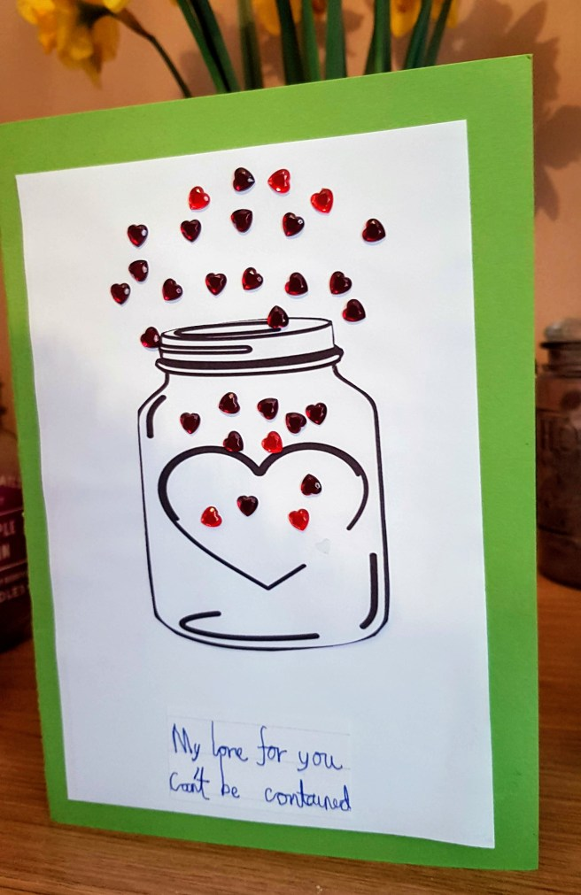 Mother's Day card, green background with outline drawing of a jar with stick on hearts pouring out of it and the word 'my love for you can't be contained.'