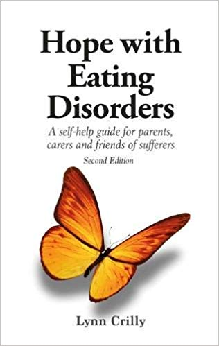 front cover of book Hope with Eating disorders - plain white background with text and big yellow butterfly.