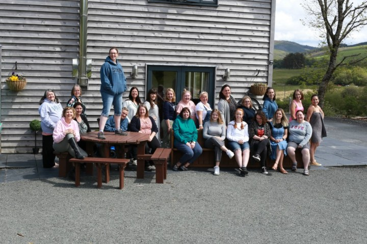 photograph of 23 bloggers, some sitting some standing in TyhnRyd retreat, Wales