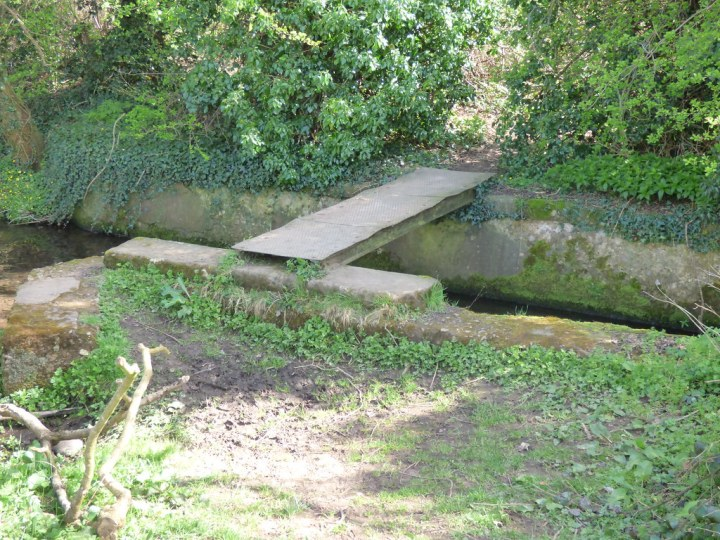 metal bridge over a brook