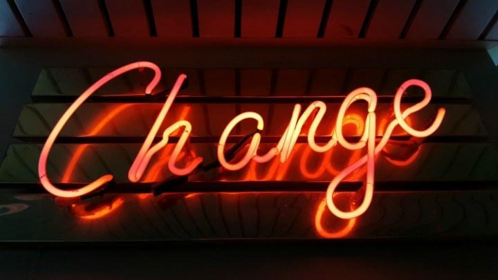change, in lights on a dark plank background