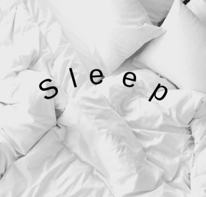 white bedding with the word sleep