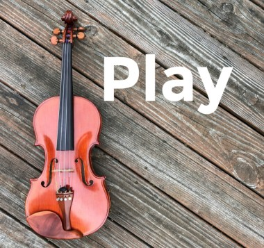 Photograph of a violin against a wooden background and the word Play.