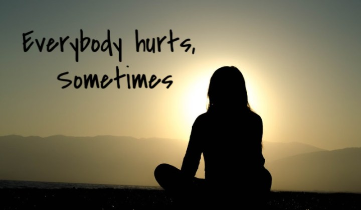 Everybody hurts, sometimes. A sillouhette of a woman from the back sitting