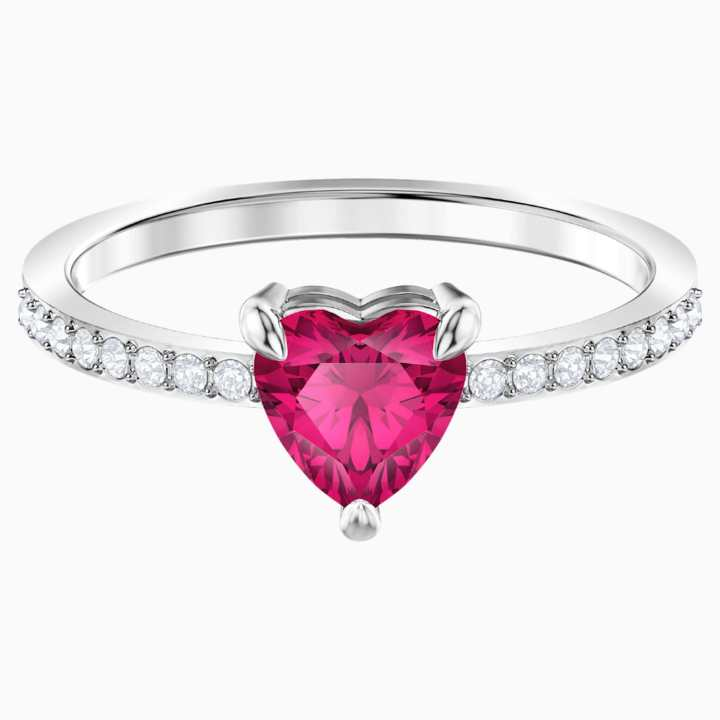 a rhodium plated ring with a big red heart stone.