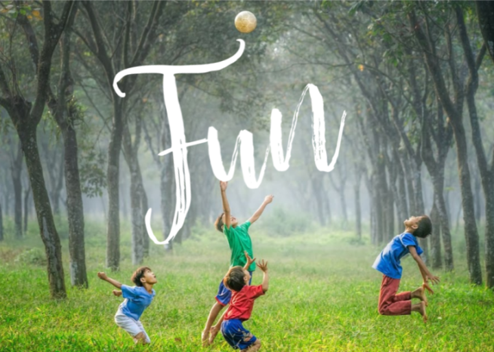 Fun -  a group of children in the woods having fun playing with a ball and the Word Fun in the middle
