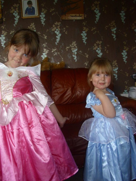 two little girls dressed up in princess costumes