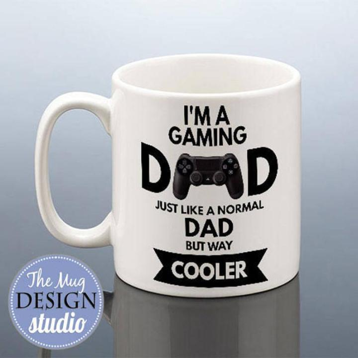 White mug with words, I'm a a gaming Dad (a replaced with game controler) just like a normal Dad but way cooler