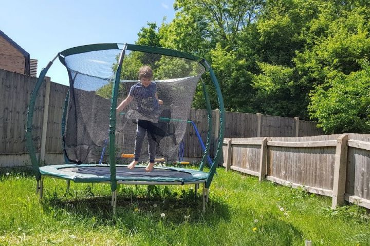 The Little Man on the trampoline in the garden