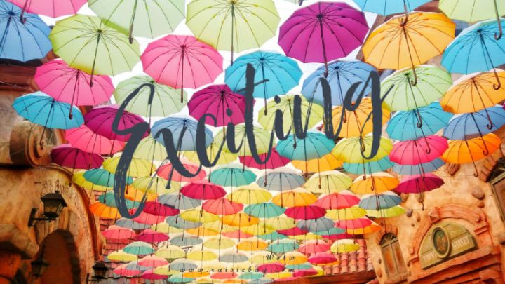 image shows a ceiling made of colourful umbrellas with the word Exciting across the middle