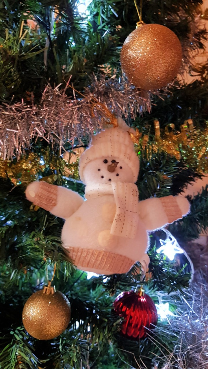 Christmas feeling, a  white snowman ornament on my Christmas tree.