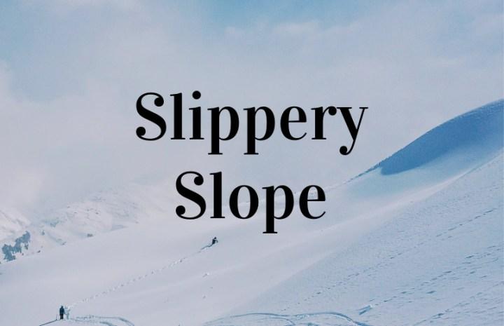 slippery slope written on a ski slope