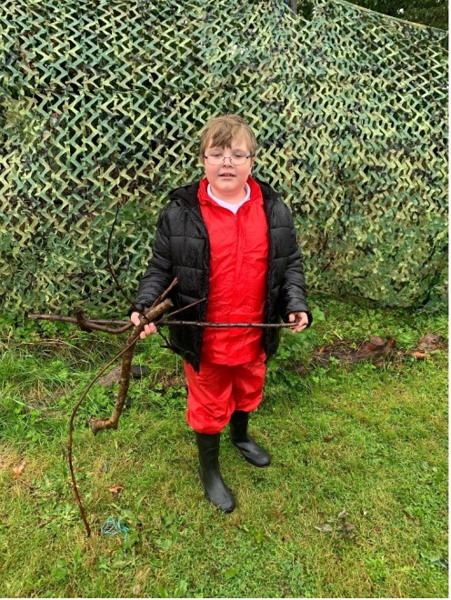 photo of my Little Man in his wet weather wear at Forest school. We are really missing school.