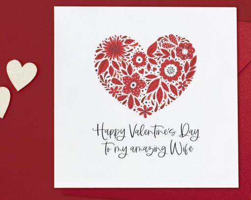 red hearts and flowers on valentines card