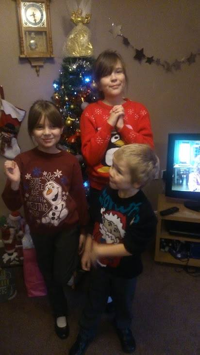funny kids in their Christmas jumpers